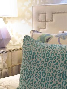 love this headboard! I've never before seen a padded headboard with a solid edge like this one.