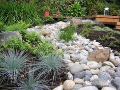 River rocks are typically 1 inch and larger in diameter and used to create dry creek beds or direct drainage.