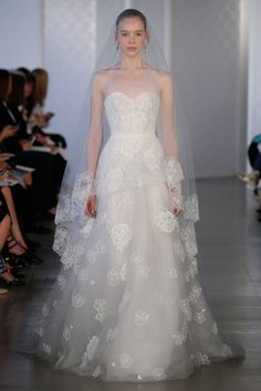 Strapless white wedding gown by Oscar De La Renta