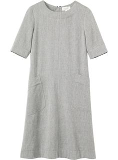 A-line dress with two deep patch pockets In a drapey, Italian-spun wool blend. Lightly fitted at the top and across the shoulders, flaring into a full A-line shape through the body. Metal zip at back with grosgrain puller. Deep hem detailing. The Indigo colourway is a wool/tencel blend and the charcoal grey, a wool/viscose blend.