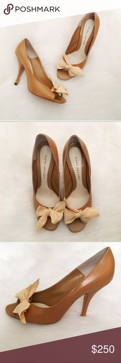Marc Jacobs Tan Bow Peeptoe Pumps NWT. Marc Jacobs tan leather peep toe pumps with adorable ribbon detail. Never worn, the right shoe was the display shoe at Barneys. The most lightweight & dainty shoes! Super rare & hard to find. Comes with box but not original. Made in Italy. Size 38.5. No modeling/trades. Marc Jacobs Shoes Heels