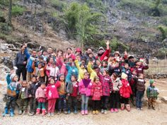 This is the fourth year that we have given school supplies or snacks to Lin Wang School. The kids are getting where they recognize us now. School was out but they came hiking over the sharp mountains.
