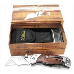 Vermont Folding Utility Knife 2 in 1. Best Box Cutter with Belt Clip, Wooden Handle and Stainless Steel. Carrying Pouch, 5 Extra Blades Set Included. ✅ BEST GIFT - Ready to give Packaging - Delivered in a Beautiful Gift Box Set, making it the perfect present for any occasion. ✅ LINER LOCK SAFETY - Hand Crafted, The king of Utility Knives. Skillfully made by hand. Easily Foldable to a Compact Size. Quality and Craftsmanship are our top priority. Silky smooth finish wood handle. ✅ BUILT TO...
