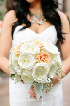 white wedding bouquet with peach accents