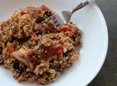 "Slow Cooker Chicken and rice 1 tablespoon Extra Virgin olive oil 1 small yellow onion, diced ½ cup diced red bell pepper 1 cup wild rice blend, uncooked (wild rice, long and short grain brown rice) 2 (thawed) chicken breasts fillets, skinless, cut into 2"" pieces 1 cup chicken broth, fat free, low sodium 1 (14.5 ounce) can diced tomatoes with liquid ½ teaspoon freshly ground black pepper ½ teaspoon cayenne pepper (optional) ½ teaspoon red pepper flakes Salt to taste"