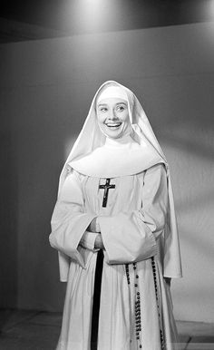 """Audrey Hepburn smiles at Rome's Cinecitta studios, Jan. as she tested for her role in a new film, """"The Nun's Story"""", taken from Kathryn Hulme's bestseller. (AP Photo/A. Audrey Hepburn, British Actresses, Actors & Actresses, The Nun's Story, Fred Zinnemann, Medieval, Broadway, Religion, Bride Of Christ"""