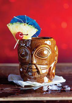 Tiki Bandit: Pineapple Juice, Ginger Ale, Gold Rum, Pineapple Rum, Blue Curaçao, Orgeat, Passion Fruit Syrup, Grapefruit Juice, Pineapple, Maraschino Cherry.