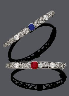 ANTIQUE BURMESE RUBY AND DIAMOND, AND KASHMIR SAPPHIRE AND DIAMOND BANGLES, CIRCA 1900. Mounted in rhodium-plated silver and rose gold.