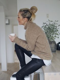 bun, tan mohair turtleneck sweater, layered striped shirt and leather pants #style #fashion #hair
