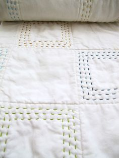 Good idea- quilt some squares with multiple rows then leave some empty- and use different color thread!