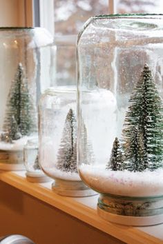Make your own snow globes, but with a jar. Glue trees/what ever you want on the inside to the lid, I'd put a piece of Styrofoam on the lid first to give everything enough height to look right.