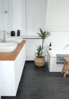 large grey bathroom floor tiles - though this is dark and would need lighter contrast