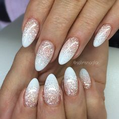 In love with these almond shaped nails sporting a white-tipped gradient with holo glitter fade #nailart Source