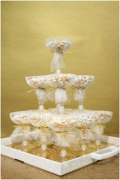 """Such a cute """"champagne"""" tower for guests! 