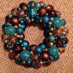 Beautiful chocolate brown, teal and gold christmas wreath made from shatterproof plastic ornaments on Etsy, $40.00