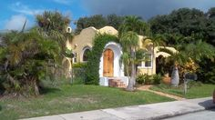 Spanish bungalow, circa 1930s.  The yellow house is located in the Mango Grove Neighborhood, Lake Worth, FL.