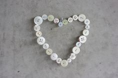 cute wall art made out of buttons and wire. very simple but very pretty