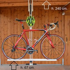 Pneumatic-lift bike rack, stores bicycle (and helmet) flat against ceiling of home or garage.