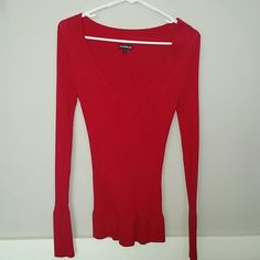 Express red ribbed v-neck sweater Size small, red ribbed v-neck.  I don't dry sweaters so it is longer in length and shoulder os stretched from hanger but can easily be fixed by washing and laying flat to dry! Express Sweaters V-Necks