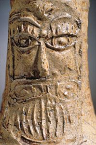 "Title:  Bellarmine jug Date:  ca. 1672 Place:  Chelsea (London, England) ? Format:  Dark buff stoneware / salt glaze / H.: 8 7/8"" (22.5 cm); Diam. (body): 5 1/4"" (13.3 cm) Description:  Image Description: Detail: bearded man stamp"