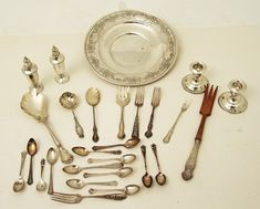 """MISCELLANEOUS LOT OF STERLING SILVER RELATED ITEMS CONSISTING OF A 10"""" GORHAM EMBOSSED SHALLOW BOWL, 8.75"""" TRI-LOBED SPOON, TEA STRAINER WITH CROWN TOP, MEAT FORK, , FRUIT SPOON AND VARIOUS OTHER FLATWARE, ALONG WITH A WEIGHTED SALT AND PEPPER, WEIGHTED PAIR OF CANDLESTICKS;  APPROX. 26 PCS.,  20 TROY OZS. WEIGHABLE"""