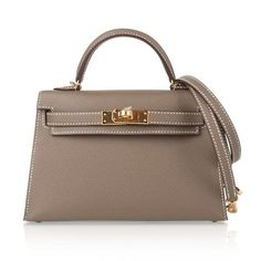 Guaranteed authentic Hermes Kelly 20 Sellier Mini ll bag.Coveted neutral Etoupe Epsom leather with gold. Hermes Bags, Hermes Handbags, Louis Vuitton Handbags, Fashion Handbags, Fashion Bags, Fashion Fashion, Runway Fashion, Fashion Trends, Sac Hermes Kelly