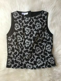 Length: 19 in. Made in France. Preowned, in great used condition, minor signs of wear. Pleated Shirt, Black Sleeveless Top, Dressy Tops, Knitted Tank Top, Black Tank Tops, Black Blouse, Floral Embroidery, Long Sleeve Tops, Size 2