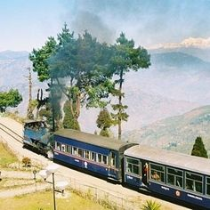 "Scenic Train Rides: No. 4 ~ Darjeeling Himilayan Railway: its 2 ft. distance between rails requires cars to be smaller & was nicknamed ""Toy Train."" Built in late 1800s representing a engineering marvel & still one of the world's outstanding hill passenger railways. See colorful sari-clad shoppers in cities; landscapes from dense tropical jungle & picturesque tea gardens to forests of pear, cherry & cardamom trees. Ghoom, end of the line, is the highest station in India ~ elev 7,407 ft."