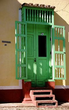 Adding a little something extra, like these gates (a common design feature in Cuba) could add so much personality!