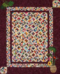 "http://ruthmccormick.com/  .  .      ""Tropical Pinwheels"" - OCQG Raffle Quilt - 69"" x 85.5""  designed by Rita Weitendorf"