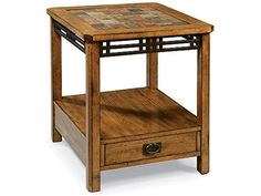 Shop for Peters-Revington End Table, 220822, and other Living Room Tables at Carolina Furniture in Amherst, NY. American Craftsman's mixed media design is constructed using oak veneers and hardwood solids, metal accents and multi-toned slate tiles.
