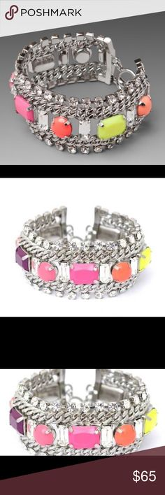 "Juicy Couture Multi Colored Gem Poolside Bracelet •Crystal and Colored stone accented bracelet measures approximately 1.25"" wide and 7.5"" in length      •Toggle closure Juicy Couture Jewelry Bracelets"