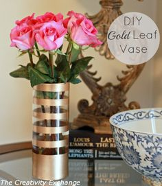 Gold striped vase made with gold paint and painters tape {How to Paint on Glass} The Creativity Exchange