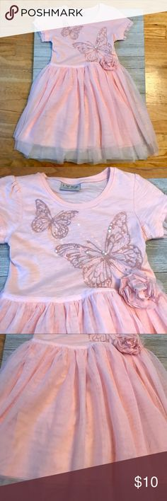 Next UK sparkly butterfly T-shirt dress 5-6 yrs Gorgeous butterfly dress from Next UK. Soft cotton jersey with tulle skirt. Sparkly sequins on the embroidered butterfly design. Size 5-6 yrs. Like new! Next UK Dresses Casual