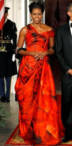 Look of the Day › January 20, 2011 WHAT SHE WORE Mrs. Obama hosted a state dinner for the Republic of China in a stunning silk organza Alexander McQueen gown paired with ruby and geode Kimberly McDonald earrings. WHY WE LOVE IT No wonder red is a lucky color in Chinese culture! This printed scarlet design was another bold and iconic choice for the fashionable First Lady.