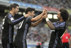Marco Asensio is joined by Alvaro Morata and Marcelo after scoring Real Madrid's second goal