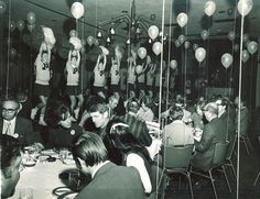 1971 University of Minnesota Homecoming Pep fest Luncheon with cheerleaders energizing the crowd.