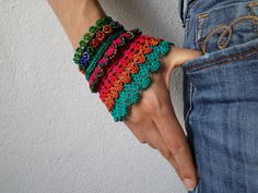 https://flic.kr/p/oALYQX   Gladiolus imbricatus: freeform crochet bracelet with blue, emerald green, magenta pink, orange beaded flowers and lace details by irregularexpressions