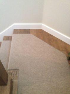 Wool carpet at transition/landing of stair case