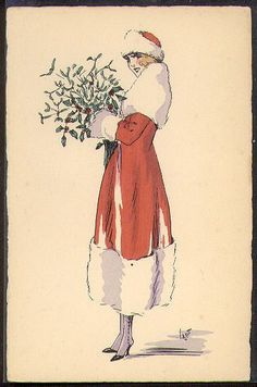 Woman in a red coat and a red hat with lots of white fur trim holding a bunch of mistletoe.