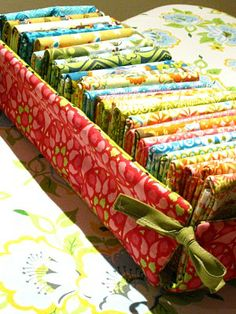 Make fabric covered trays in different widths for organizing smaller pieces of fabric. These can go on the top shelf of the cabinet. May also work for trims wrapped on cards.