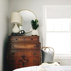 I don't necessarily like the individual styles of each piece, but I like the idea of the mirror, lamp, etc on a dresser.