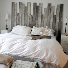 Such an adorable headboard especially for a beach themed room. Use old pallet slats.