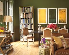 A mix of strong colors and styles (Louis XV–style chairs from a Paris flea market surround an IKEA table) create casual elegance in a Harlem, New York dining area.    - ELLEDecor.com
