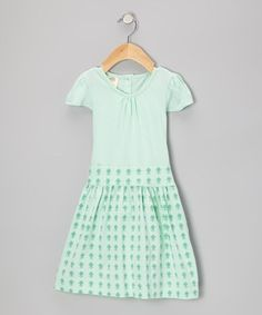 Made from soft organic cotton with a twirl-worthy skirt that ties in back with an adjustable sash, this fanciful frock is comfy and gentle on sensitive skin. The stylish design features a pretty print, dainty cap sleeves and buttons in back for easy dressing.