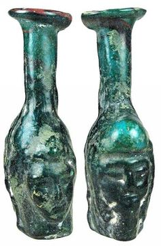 """ROMAN  Turquoise mold-blown glass bottle of Janus, the Roman God of beginnings and endings. 50-100 AD (4"""" x 2"""").  #Roman #ancient #Janus #glass #art #artifact #turquoise"""