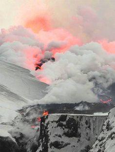 Flowing lava vaporizing snow - Fimmvorduhals, Iceland.
