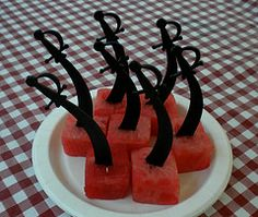 Pirate swords in watermelon chunks (other foods cut into chunks would also work)