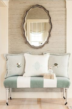 Entryway Decor Ideas. Great entryway with grasscloth wallpaper, custom bench and throw pillows in a coastal color palette. #Entryway #Foyer Casabella Home Furnishings and Interiors.