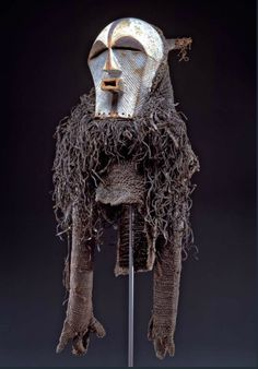 Africa   Mask ~ kifwebe ~ and costume from the Songye or Luba people of DR Congo   Late 19th to early 20th century   Wood, paint, fiber, cane and gut